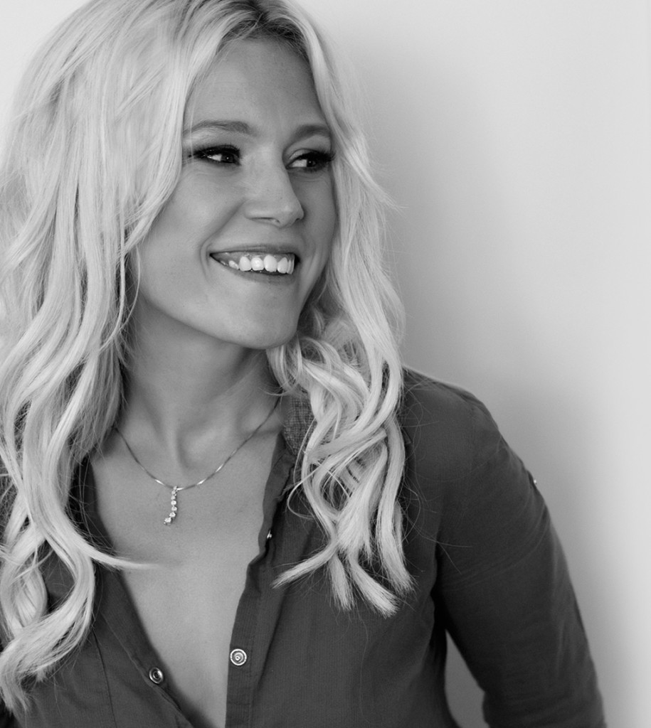 black and white image of smiling blonde woman
